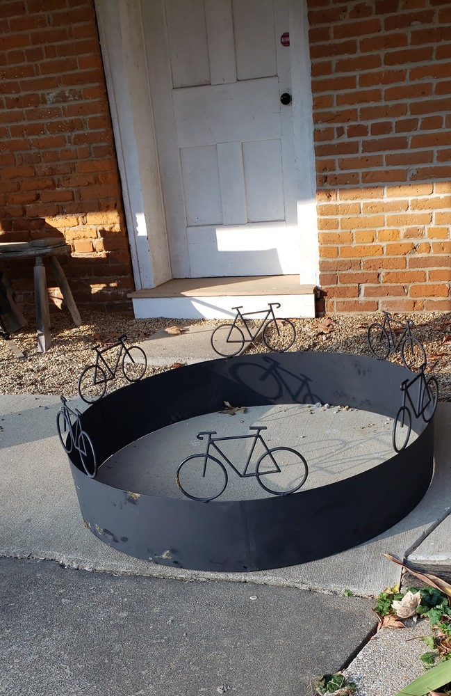 Welding Technology Classes Complete and Donate Bicycle Firepit Ring to Local Bicycle Hostel